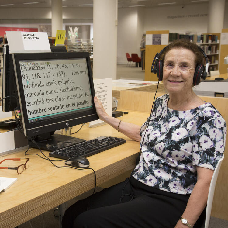 Woman using Read It Adaptive Technology in Governor Marie Bashir Reading Room