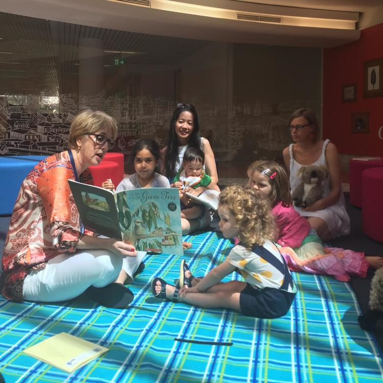 A group of pre-schoolers reading a book together