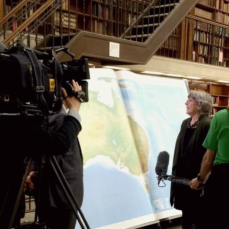 Media interviewing State Library curator Maggie Patton.