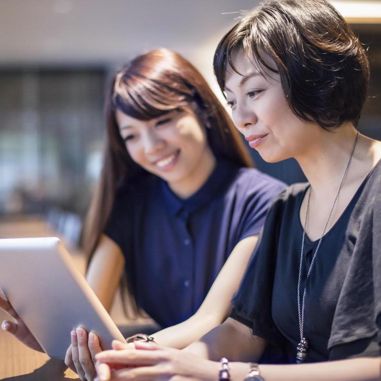 Two women using an ipad
