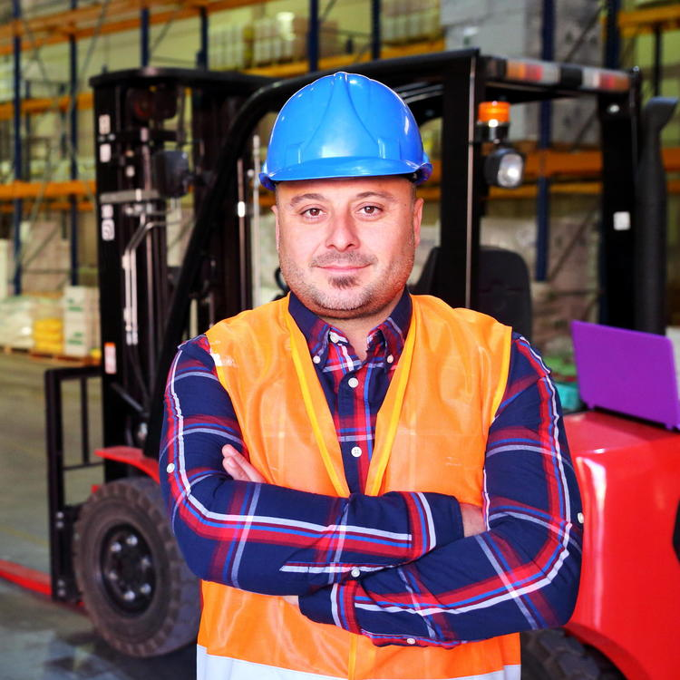 Man in hard hat standing in a warehouse