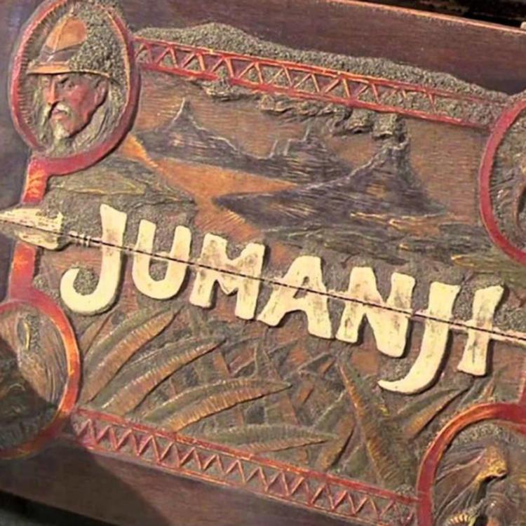 hands holding a Jumanji board game