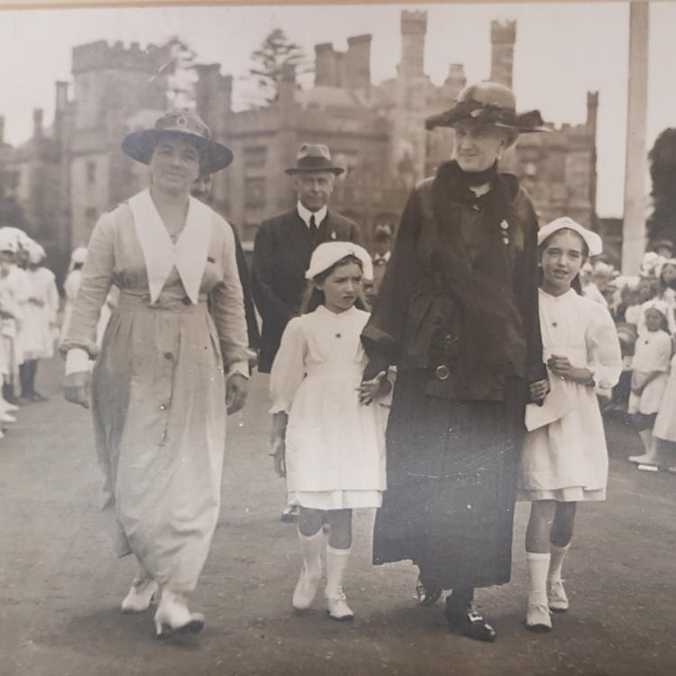 Eleanor MacKinnon (left) and Lady Strickland (right) accompanied by two female members of the Junior Red Cross at Government House, Sydney.