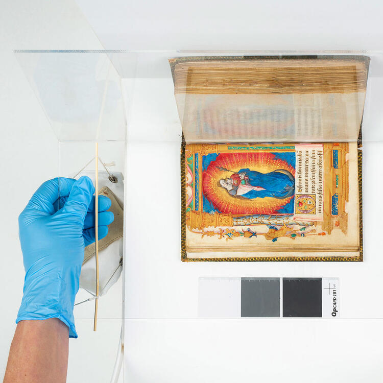 A colourful book in the process of being digitised.