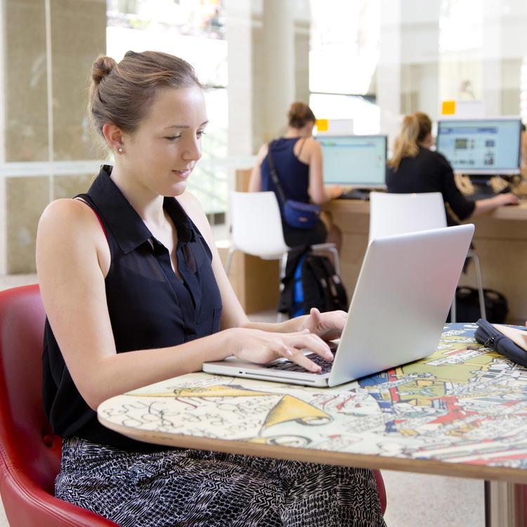 Person using laptop in the Verandah