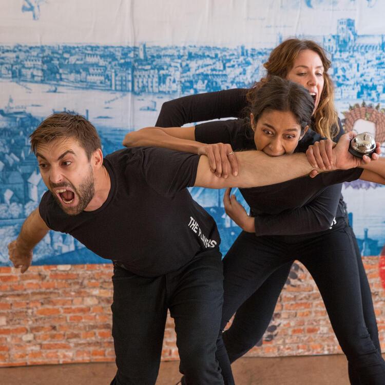 three actors in scene from Shakespeare