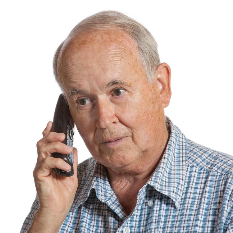 Older man talking on phone