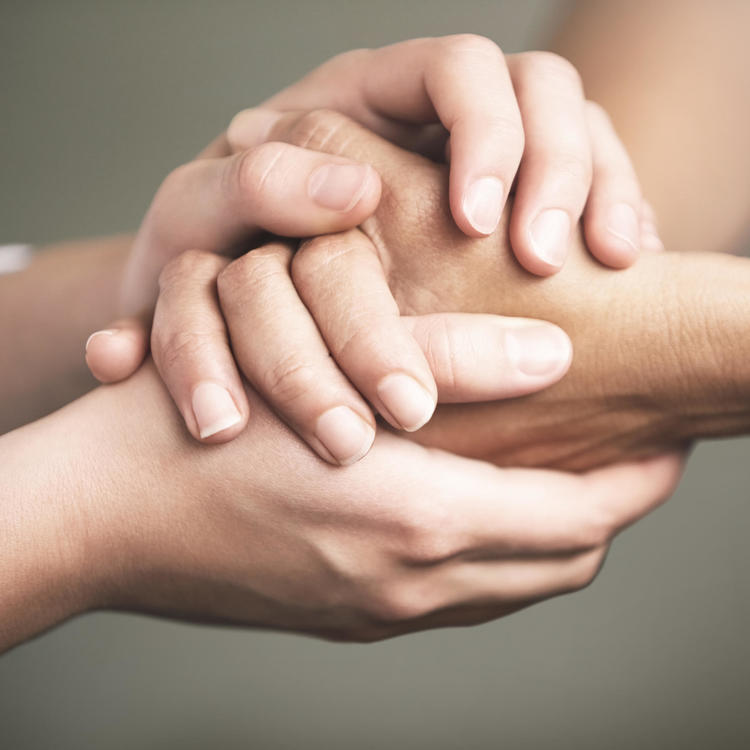 Three hands clasped together