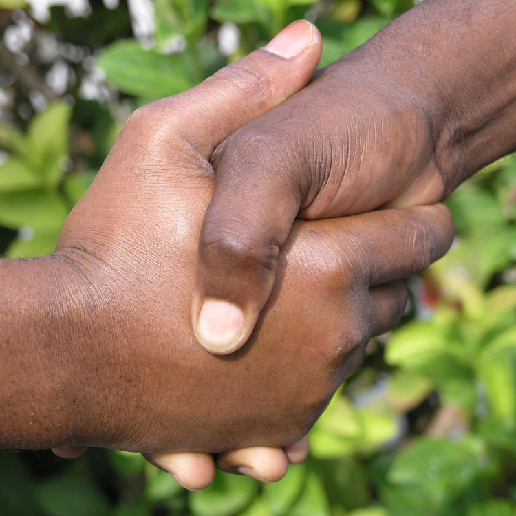 Hands of two aboriginal men shaking