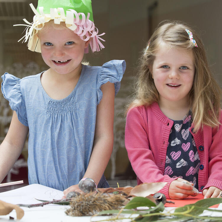 two young girls with craft material