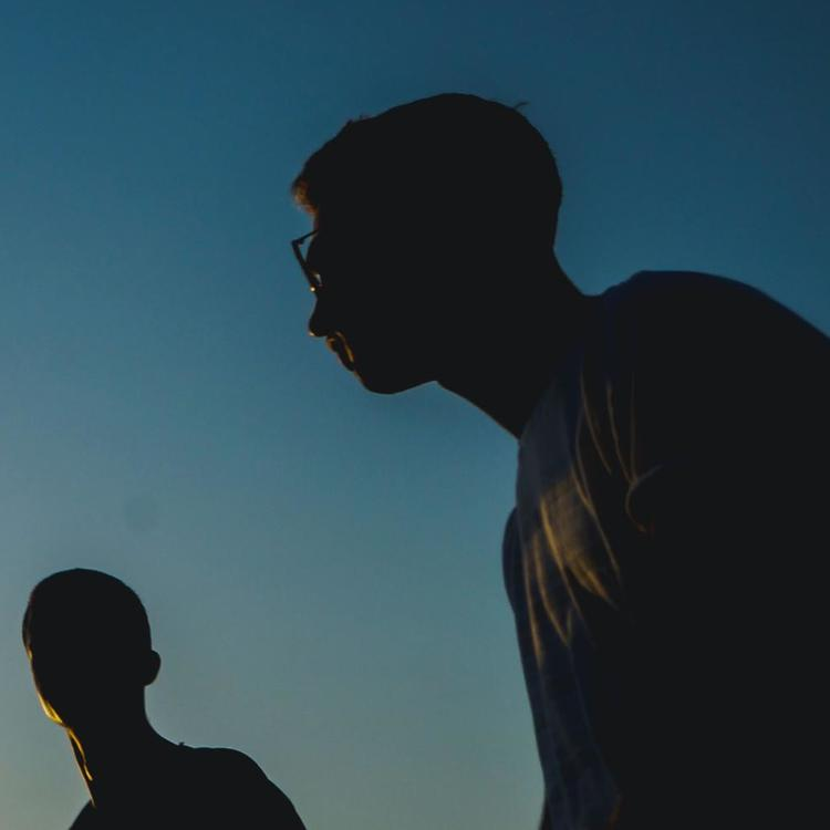 a group of youth in silhouette