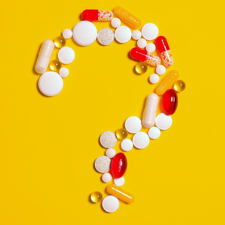 question mark made up of tablets and pills