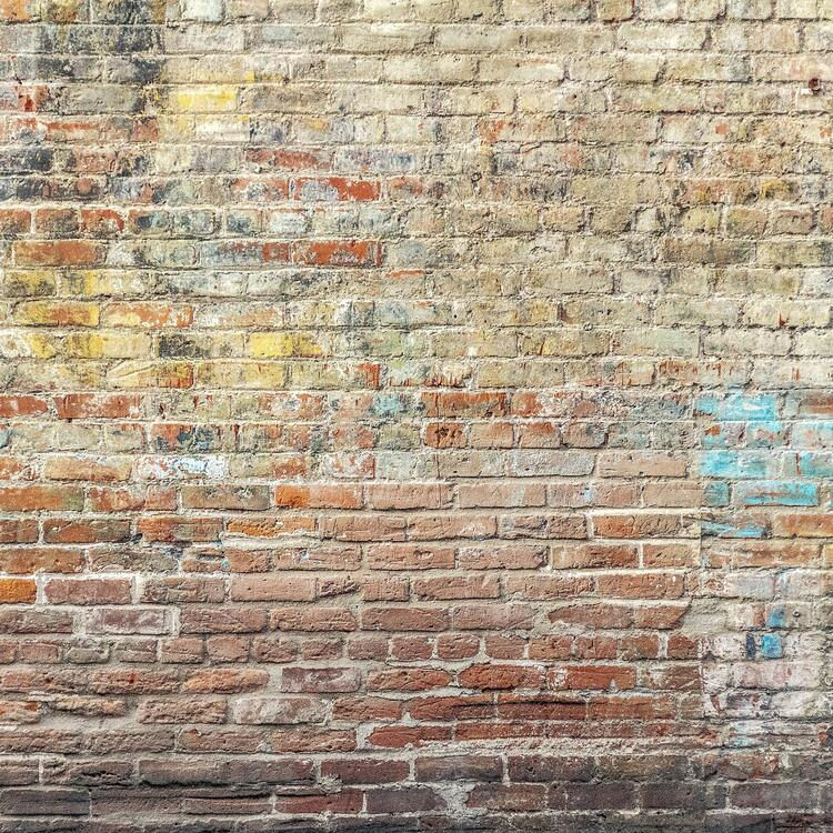 Brick wall with graffiti