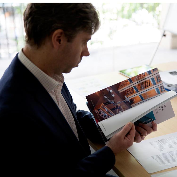 Man reading magazine at desk