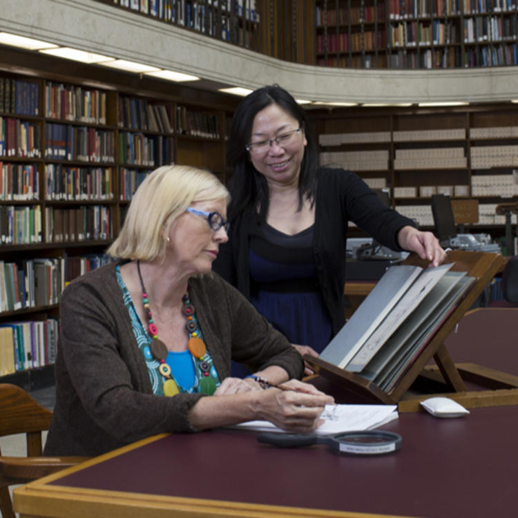 Staff and client using special collections material