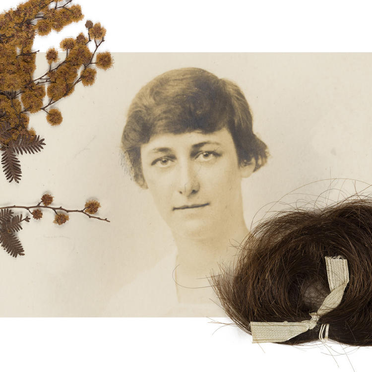 A sepia photograph of a woman framed by dried wattle sprig and a lock of hair.