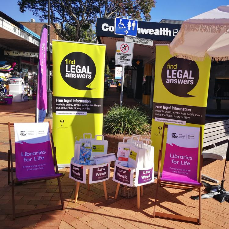 display of library material in an outdoor shopping mall
