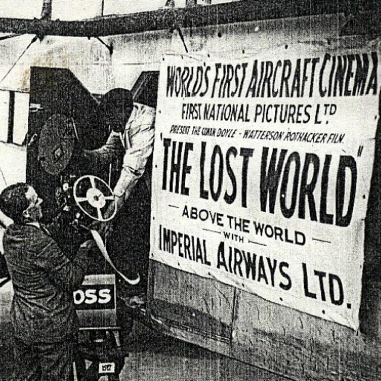 Black and white image of the Lost World movie poster being put up