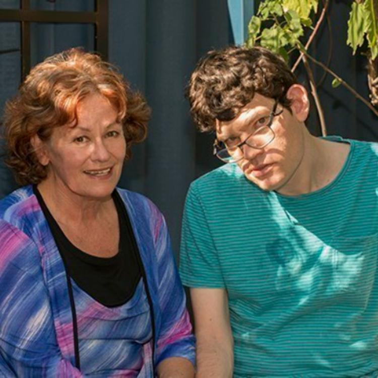 Richard and his mum Deirdre sitting outside in the sun