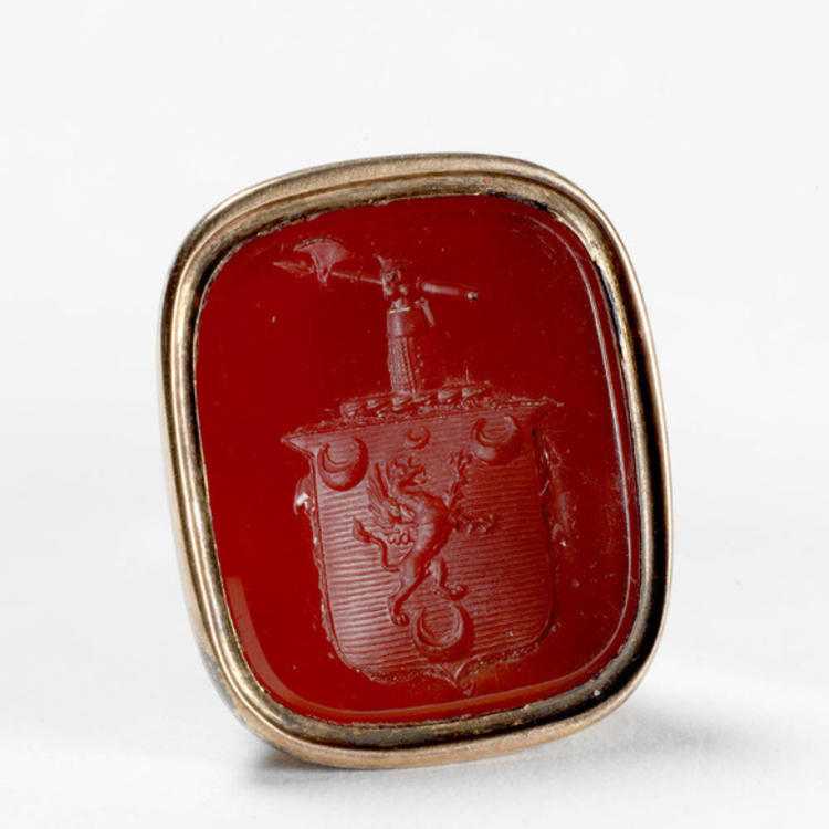 GOVERNOR BLIGHS RING DEPICTING A GRIFFIN AND QUARTERMOON ON CREST SURMOUNTED BY A MAILED ARM HOLDING AN AXE. THE MOTTO, ON THE RING BELOW THE CREST READS LINEM RESPICE.