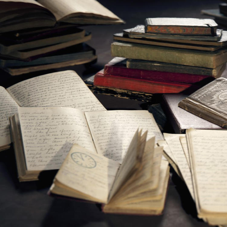 Photograph of leather bound journals and diaries