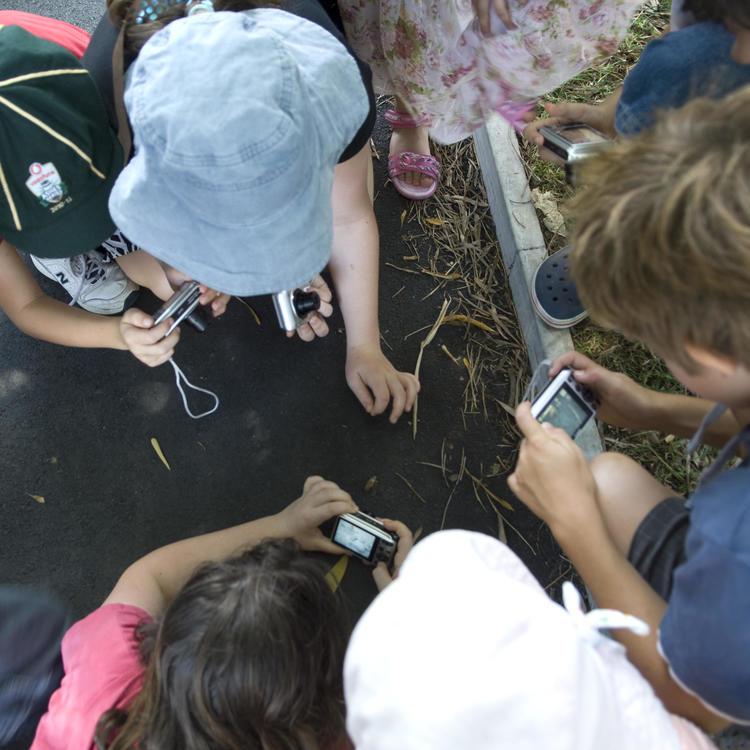 Kids using cameras for a workshop