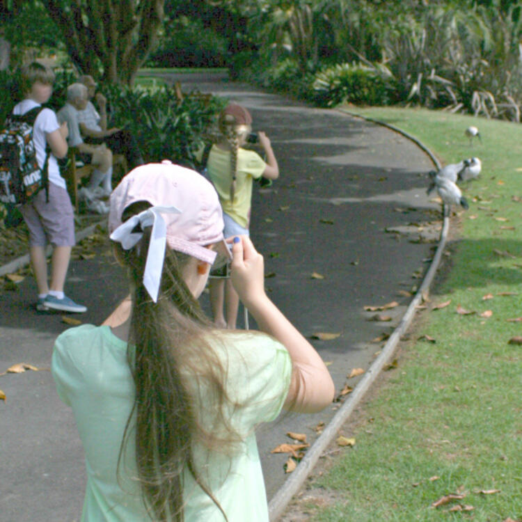 Two girls in a park, taking photos