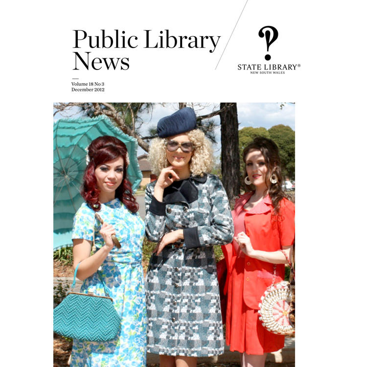 Three women with parasols and hats in 1920s dresses posing