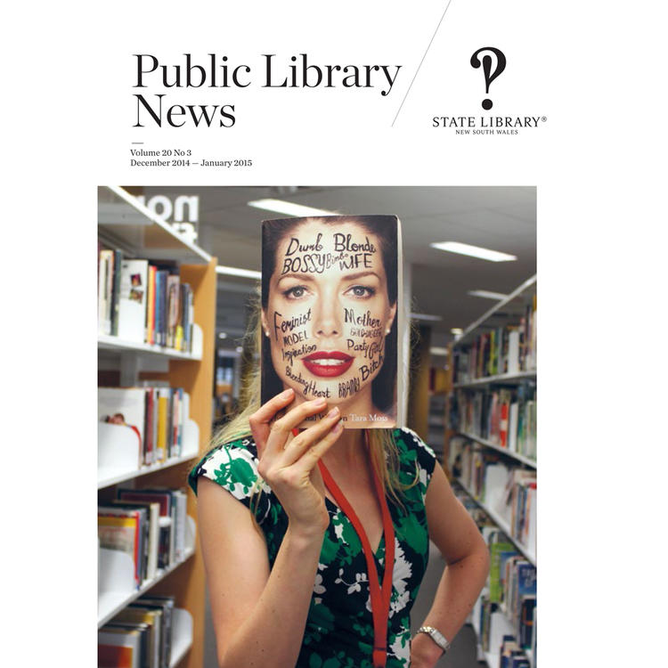 Blonde  woman holding book in front of her face