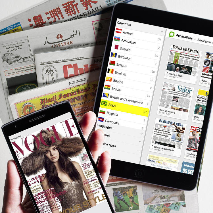 View of magazines on phone and tablet