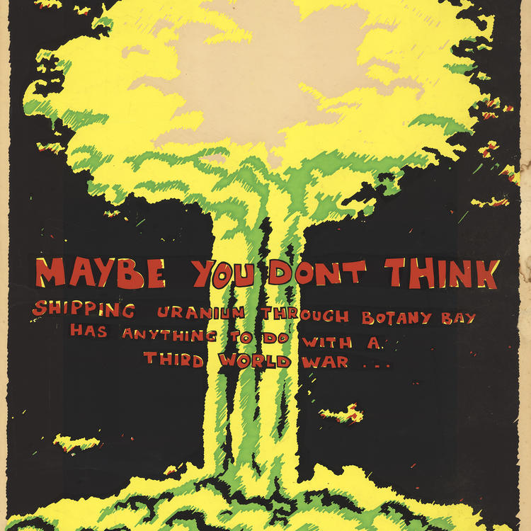 Poster showing post explosion mushroom cloud with red writing.