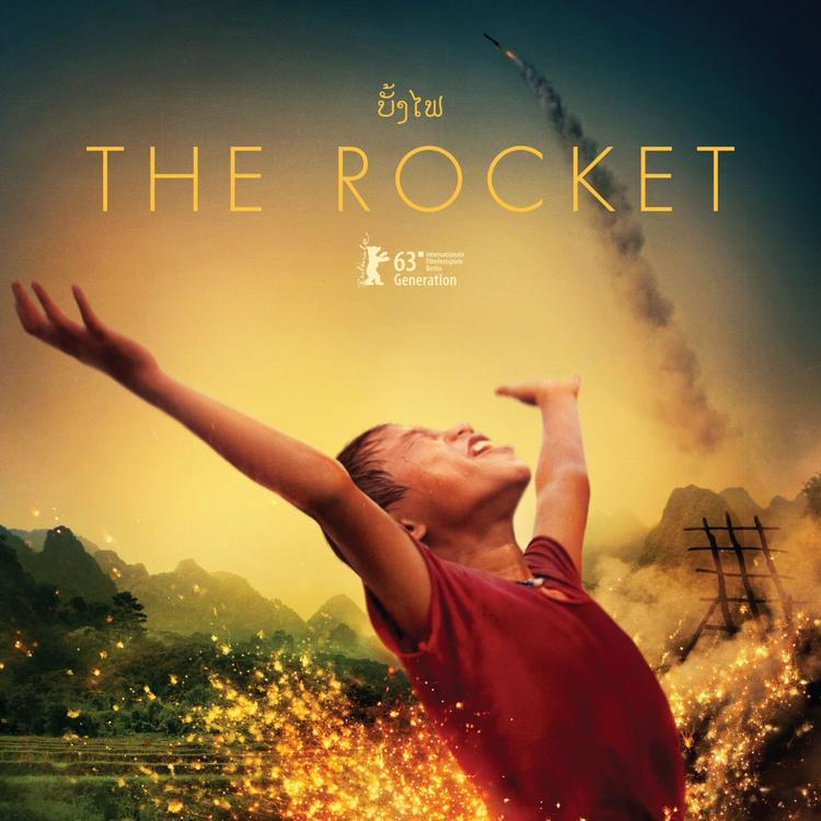 Man standing up with hands in the air on film poster for the Rocket