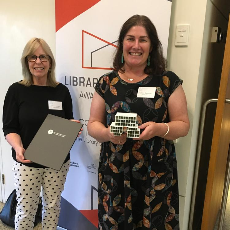 Margie Kirkness and Kathryn Baget-Juleff with the award for Shellharbour library