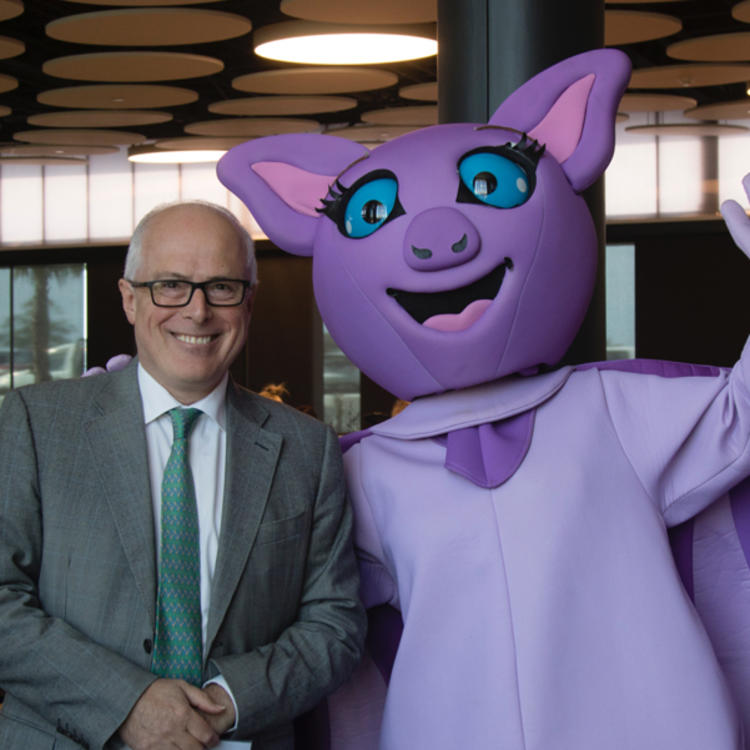 State Librarian John Vallance and bat mascot at Shellharbour Library