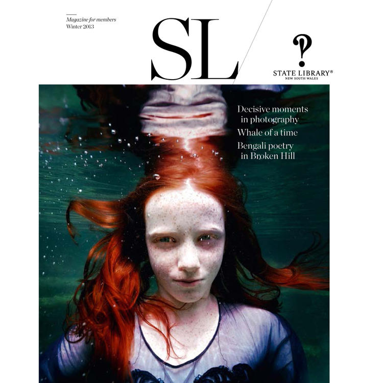 Image of a girl with long hair under water on cover of the Winter 2013 New South Wales State Library Magazine