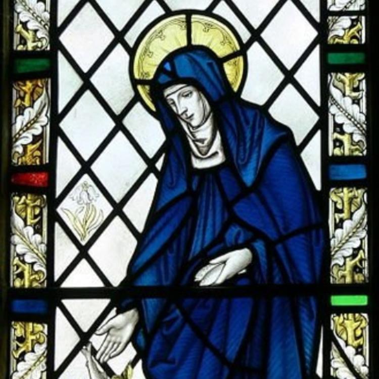 Stain glass window of St Brigid