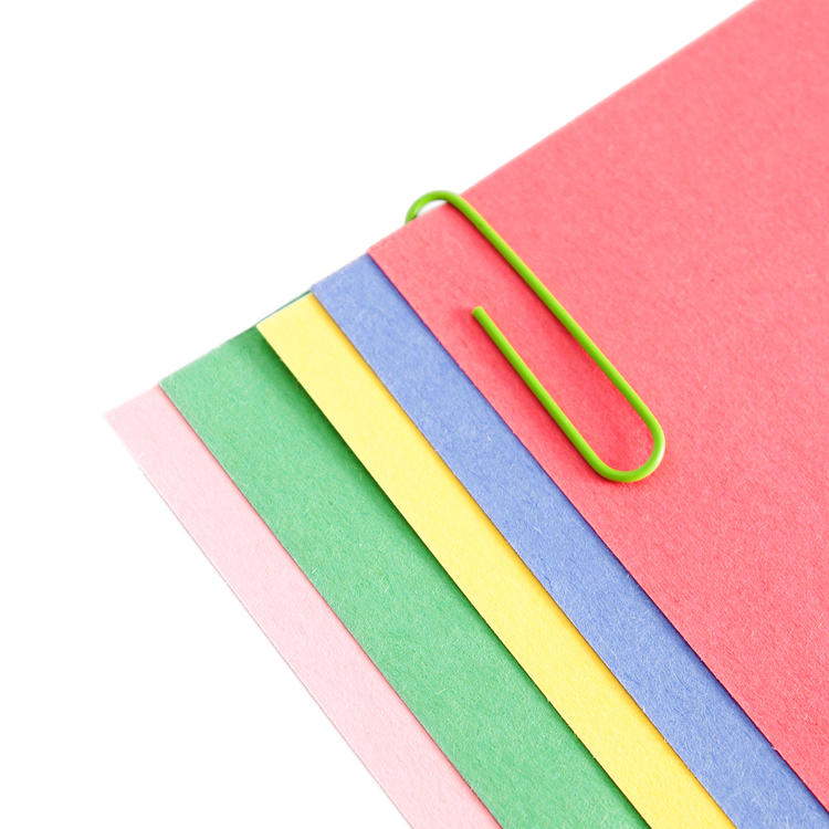 Coloured pieces of paper in a pile