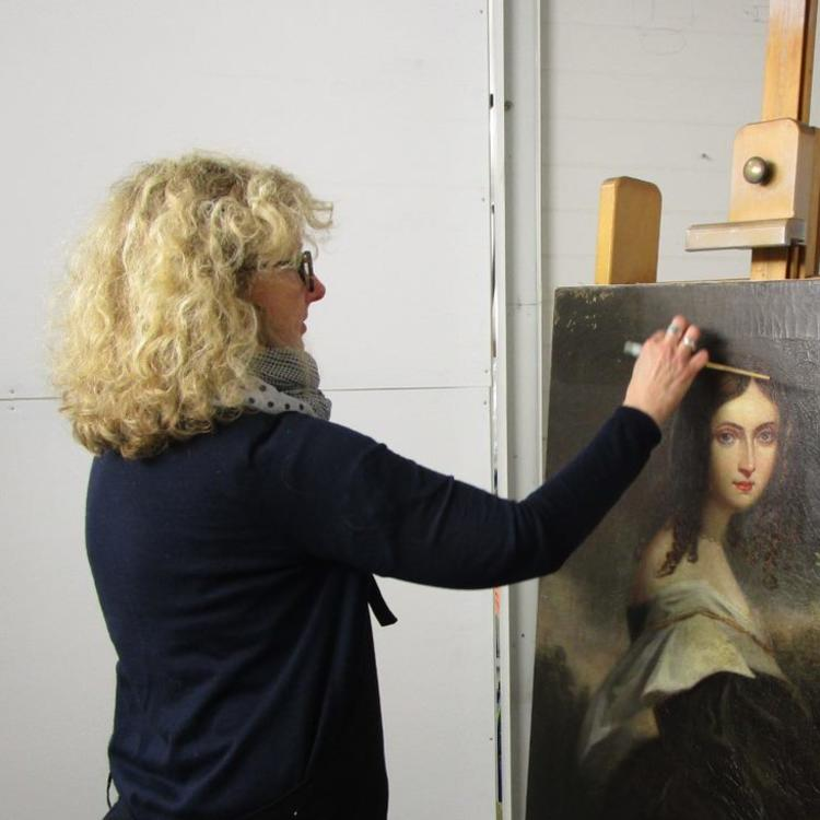 Julia Sharp, Conservation Manager, David Stein & Co, works on the painting