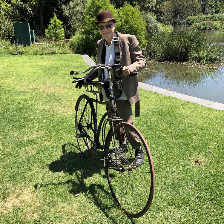 Tony Wheeler in Melbourne with a bicycle and attire from the 1890s, photo supplied
