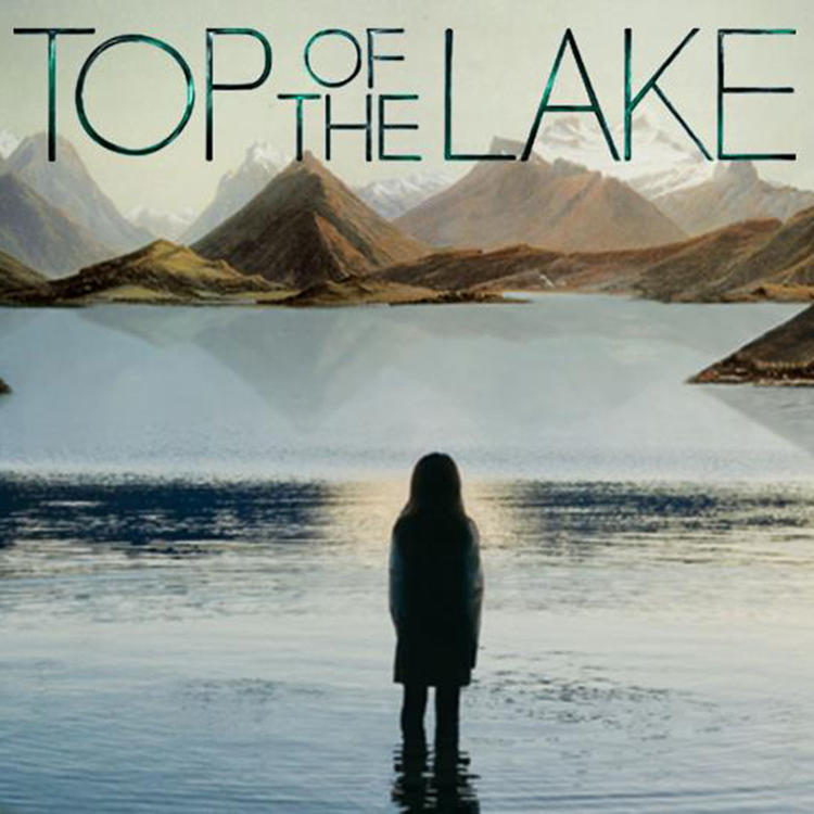 Girl standing in lake with back to camera