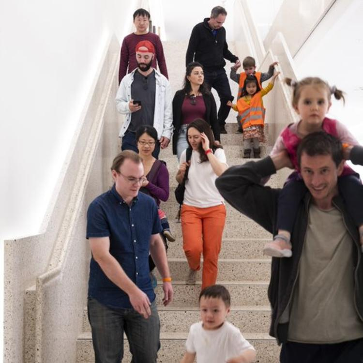 A group of people walking down a staircase