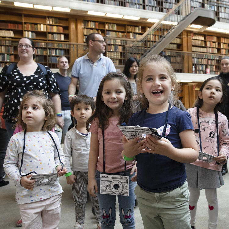 A group of children going on a tour of the Library