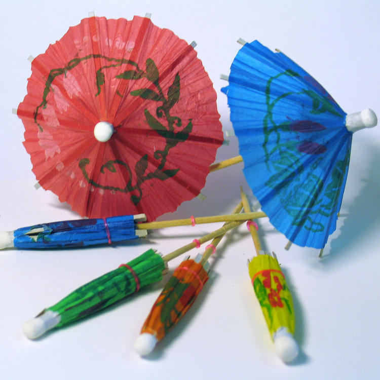 a pile of cocktail umbrellas