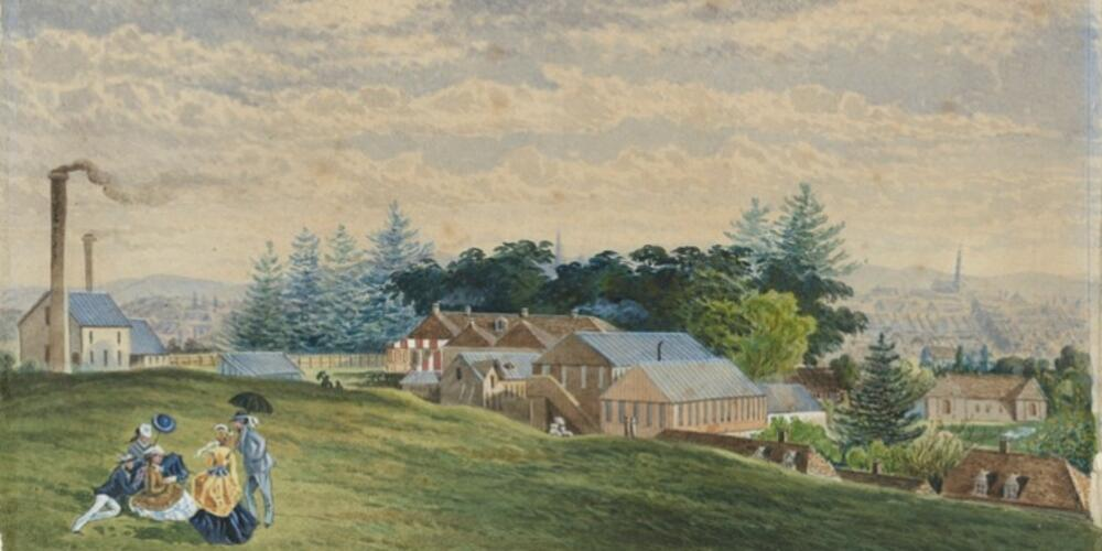 painting of people having a picnic on a hill with homes in the background