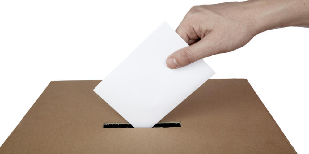 Picture of hand with ballot paper