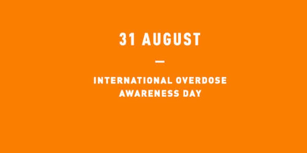 White text #OverdoseAware on an orange background
