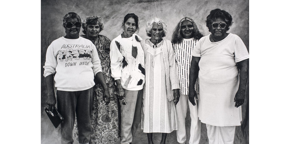 A group of women posing for the camera