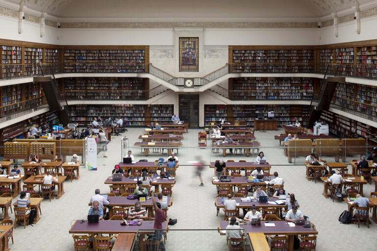 Mitchell Library Reading Room from above with bookcases and desks