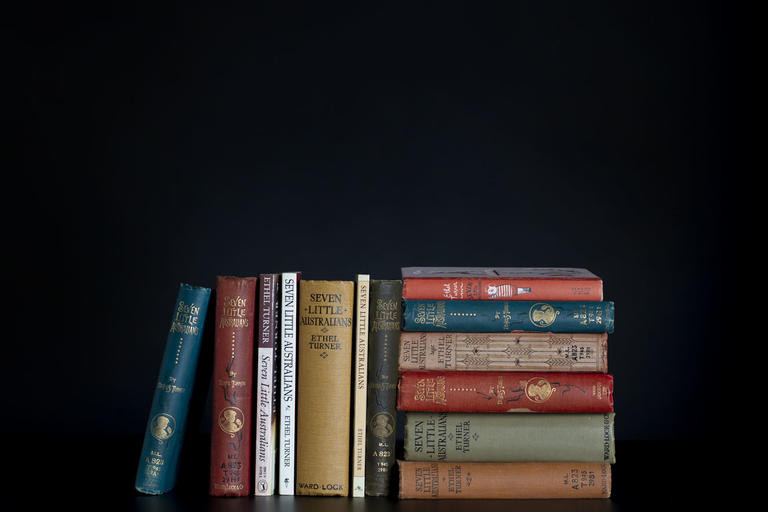 group of books leaned up against each other