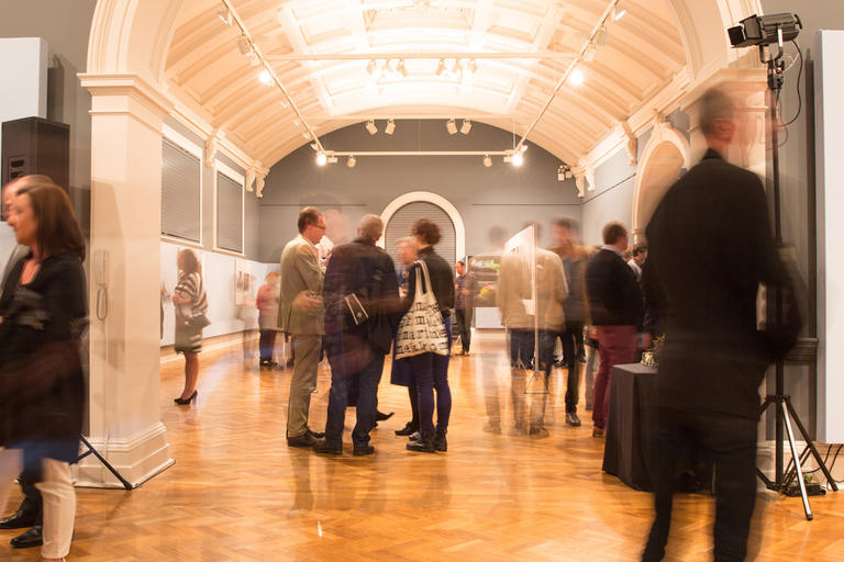 Crowds mingling in exhibition galleries